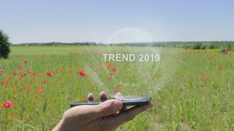 Hologram of Trend 2019 on a smartphone Footage