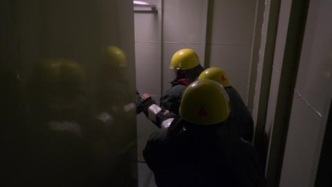 Female team of rescuers walking in dark tunnel inside building while rescue Live Action