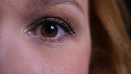 Closeup half face portrait of adult attractive caucasian womans eye looking Footage