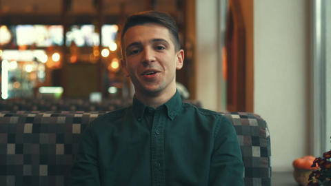 Happy attractive young man looking at the camera and... Stock Video Footage