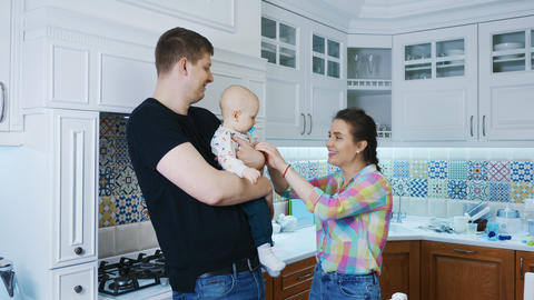 Father, mother and newborn baby boy at white kitchen... Stock Video Footage