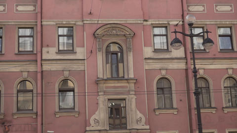 Facades of old pink historical building with several windows on sunny day Footage