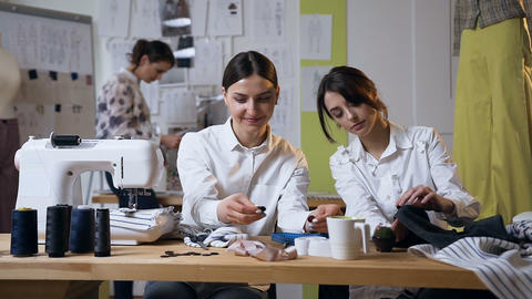Two female fashion designer working on the future clothes design Live Action