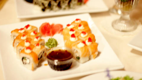 Sushi on a table with soy sauce on the holiday table.…, Live Action