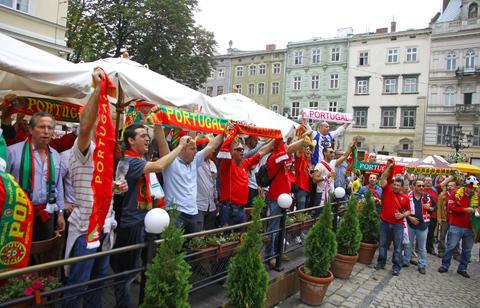 Portugal football team supporters walk on a streets of Lviv Fotografía