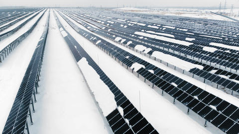 AERIAL: Photovoltaic in winter covered with snow. Solar…, Live Action