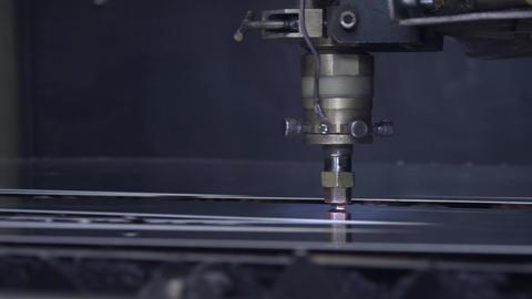 Cut sheet metal at workshop. Modern tool in heavy industry. Dangerous job. High Footage