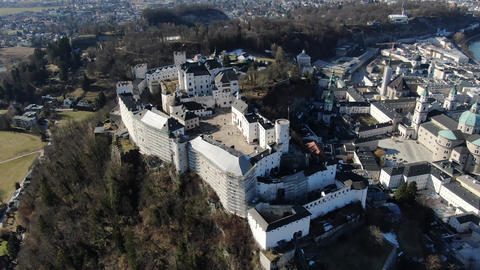 High angle footage of Hohensalzburg fortress with people walking inside, 4k Live Action