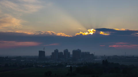 Sunset over urban city, modern downtown skyline buildings silhouettes Live Action