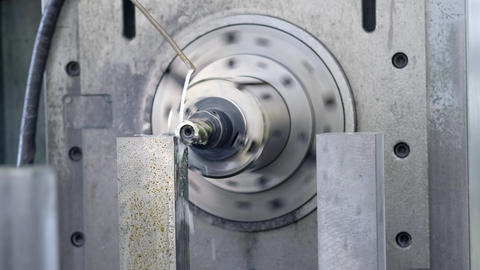 CNC Milling Machine Produces Metal Detail on Factory. Metalworking machine Live Action