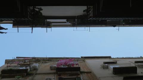 Sky and houses with linen outside, bottom view. Naples, Italy Archivo