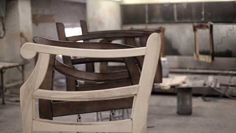 Wooden parts are varnished in the furniture factory Footage