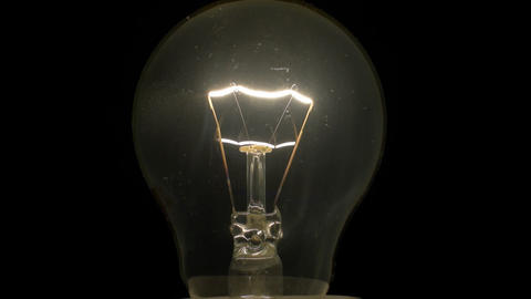 Light Bulb 02 incandescent slowly turning off and on Footage