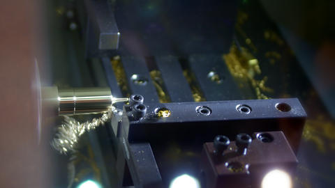 Metalworking milling machine. Produces fine gold detail in a factory. Machine Live Action