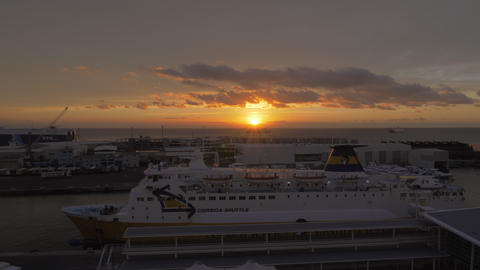 Corsica ferry moored in the port of Savona at sunset, Italy Archivo