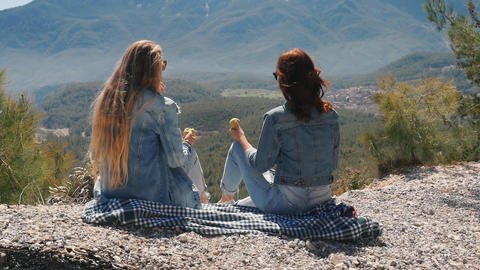 Young women at viewpoint enjoying beautiful landscape Live Action
