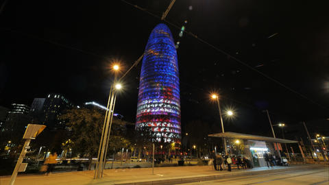 Night timelapse of Barcelona with illuminated Torre Agbar, Spain Archivo