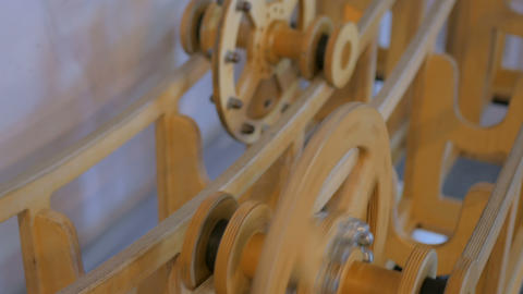 Competition of two same size wooden wheels with different weight Footage