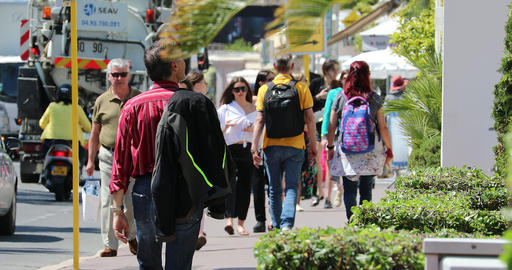 Crowd Of People Walking On The Sidewalk In Cannes GIF