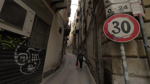 Walking through the alleyway with old houses in Palermo, Italy Archivo