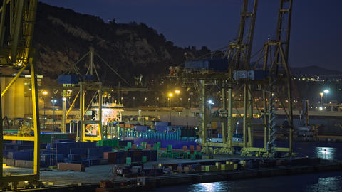 Timelapse of container traffic in industrial port at night, Spain Archivo