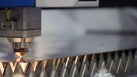 Cutting of metal. Sparks fly from laser. Industrial laser cutter with sparks Live Action