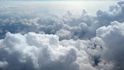 Clouds from a plane window. The view of the clouds from a plane window, 4k Footage