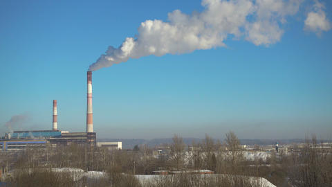 Pipes with smoke of thermal power station in winter at... Stock Video Footage