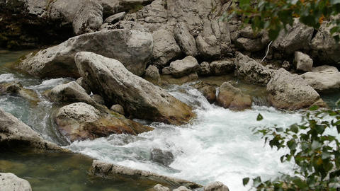 Clean water flow in rocky river in mountain close up. Rapid water stream Footage