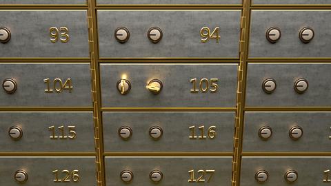 Fine gold bars inside safety deposit box GIF