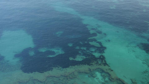 Aerial view of sea surface. Top view of transparent turquoise ocean water Footage