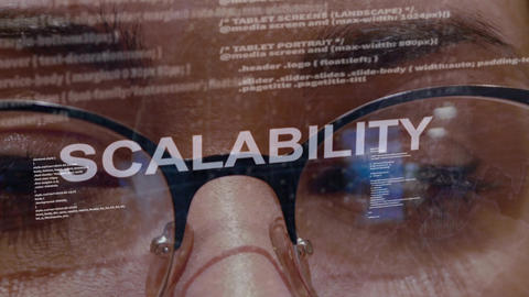 Scalability text on female software developer Live Action