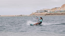 Female Kiteboarder Gliding to Shore Live Action