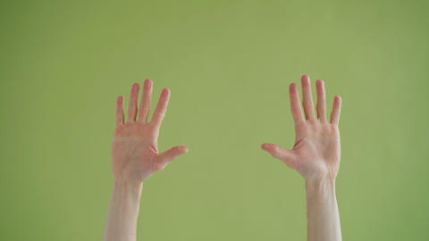Close-up shot of human male hands making praying gestures crossing fingers ビデオ