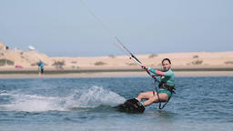 Young Woman Kitesurfing Towards Camera Live Action