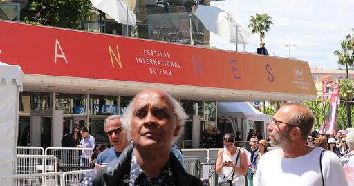 People Walking in Front of Palais des Festivals et des Congres Building in Cannes GIF