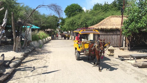 Indonesia, Bali, Gili 25 DEC 2019 - Tourist ride a traditional transport of Footage