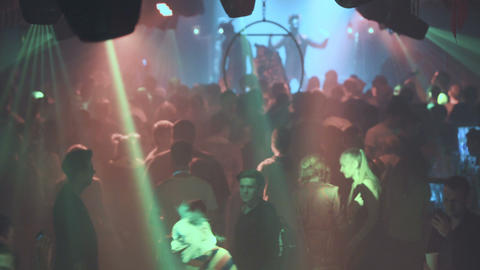 Night party, night rave. Young people having fun, taking drugs. The spotlights Live Action