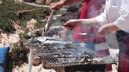 Fish Being Cooked on Outdoor Grill Archivo