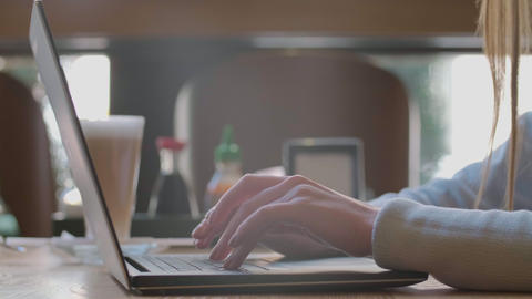 Woman typing on laptop keyboard in the office. Close up woman hands writing on Footage