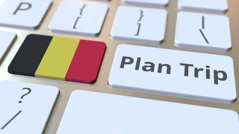 PLAN TRIP text and flag of Belgium on the computer keyboard, travel related 3D Footage