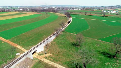 Steam Train Puffing along Amish FarmLand by Drone Footage