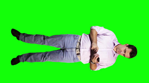 Young Man Touch Screen Phone Checking Time Full Body Greenscreen 6 Footage