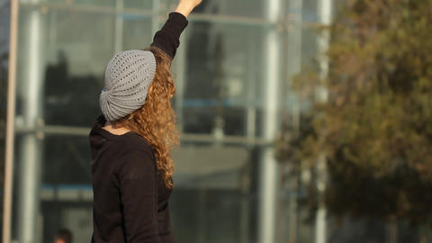 teenage girl standing in the street and looking to the sky Footage