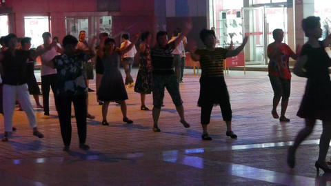 Dancing Chinese people crowd in the square at night Footage