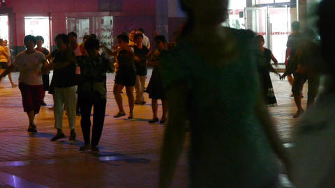 Dancing Chinese people crowd in the square at night Stock Video Footage