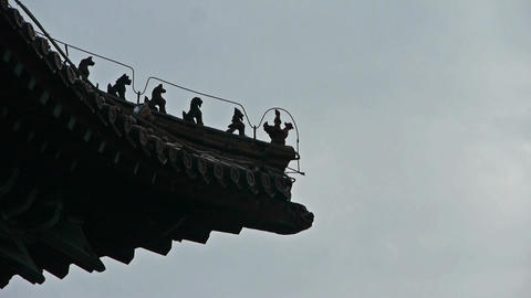 sculpture on roof eaves,China ancient architecture.carved beams & painted bu Footage