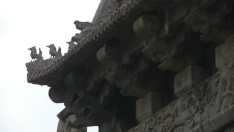 sculpture on roof eaves,China ancient architecture.Chinese stone Memorial arch Footage