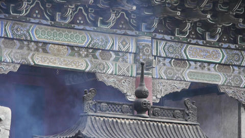 Chinese ancient building,carved-beams & painting-houses.incense burner smoki Footage