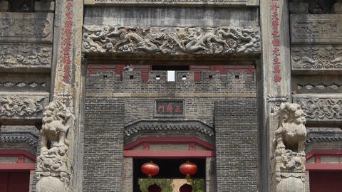 China stone arch & stone lions in front of ancient city gate Live Action